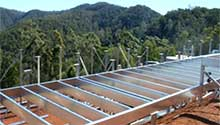 Floor system on a sloping block